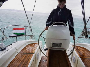 Andras Nemeth at the wheel of a yacht